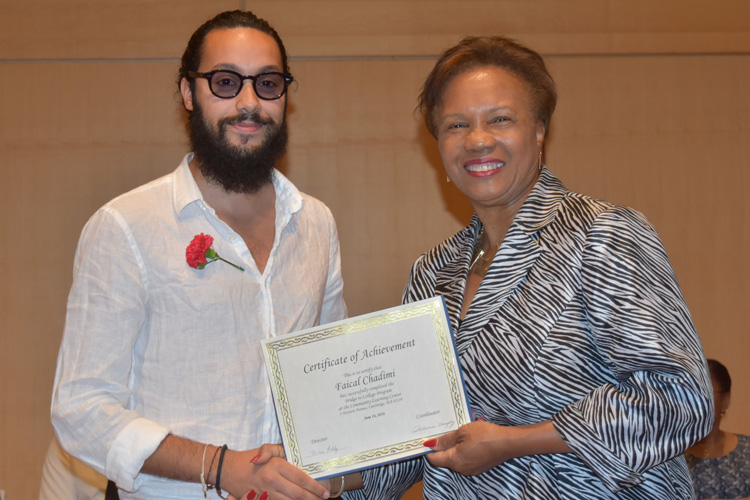 Cambridge Community Learning Center 2016 graduate Faical Chadimi with Cambridge Mayor E. Denise Simmons